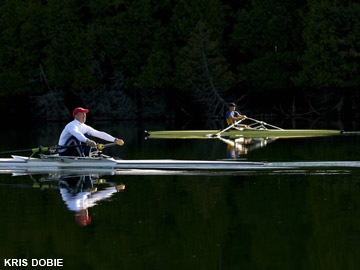 Scullers on perfectly flat water