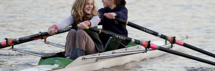 children rowing a double scull