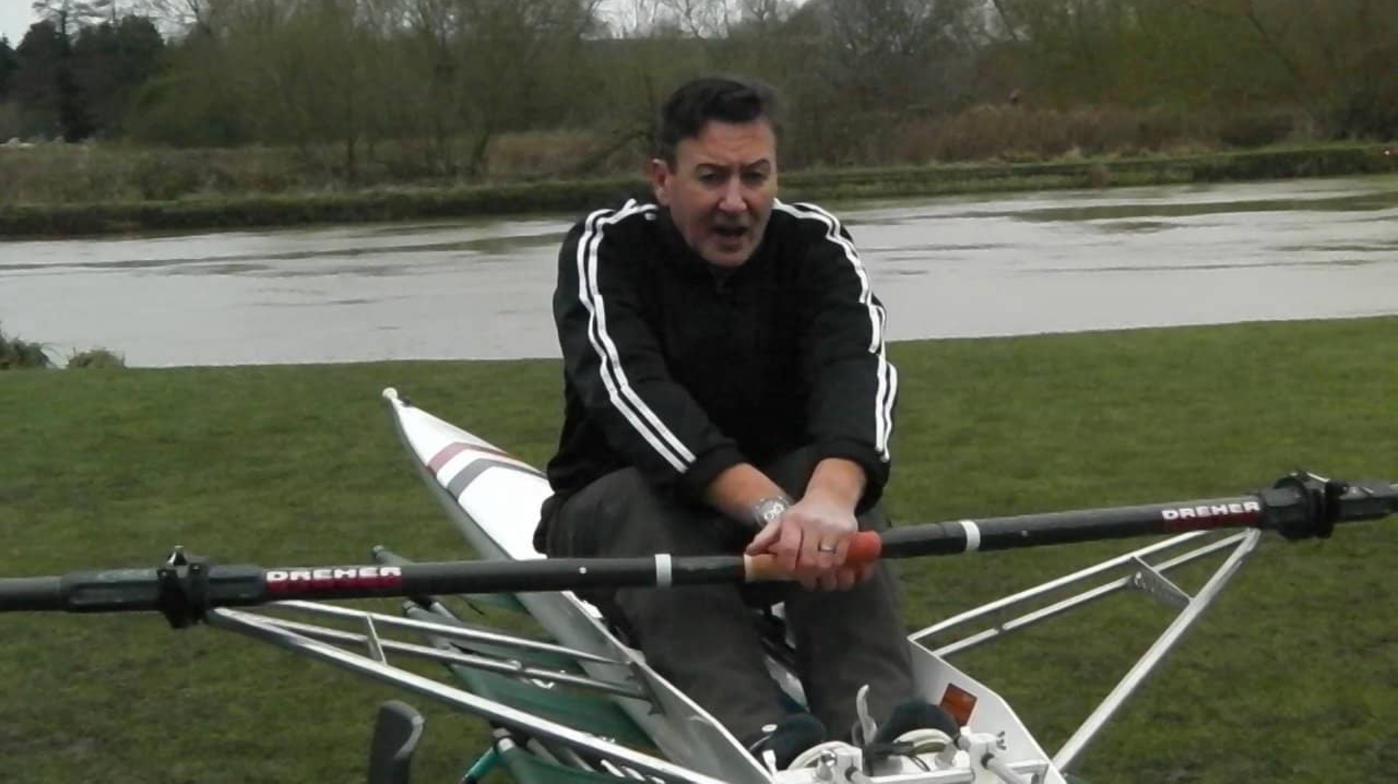 rowing Coach giving sculling instruction on the land