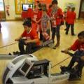 Children on rowing machines