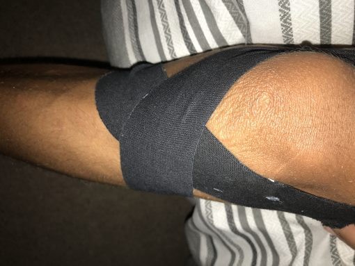 Strapping tape on knee for injury support